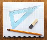 铅笔笔记本和橡皮擦 图库摄影