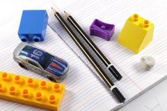 铅笔,磨削器,橡皮擦,书 免版税库存图片