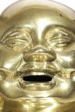 黄铜菩萨面对与笑的表示 库存照片