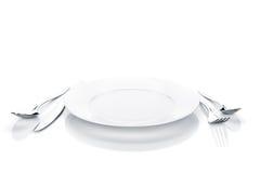 银器或扁平的餐具套叉子、匙子、刀子和板材 库存图片