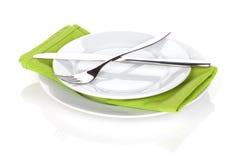 银器或扁平的餐具套叉子和刀子在板材 免版税库存照片