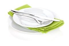 银器或扁平的餐具套叉子和刀子在板材 免版税图库摄影