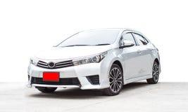 银新的汽车在白色背景的 免版税库存照片
