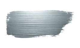 银色与闪烁纹理的画笔污点或污点冲程和抽象油漆刷闪烁的墨水轻拍污迹在白色backgroun 免版税库存图片