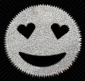 银色发光与心形的眼睛的闪烁微笑的面孔 库存照片