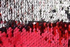 银色和桃红色衣服饰物之小金属片 免版税库存照片