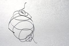 银色导线螺旋宏指令 免版税库存照片