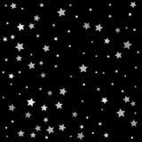 银色星五彩纸屑装饰 查出在黑色背景 库存图片