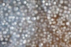 银色欢乐与bokeh的圣诞节典雅的抽象背景 免版税库存照片