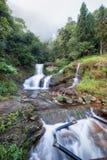 银色瀑布或Thac Bac在雾在雨季 免版税库存图片