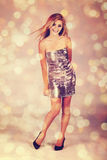 银色礼服的妇女 库存图片