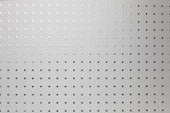银色穿孔的铝板料,背景 免版税图库摄影