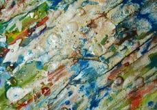 银色蓝色白色橙色背景,闪耀的泥泞的蜡状的油漆,对比塑造在淡色颜色的背景 库存图片