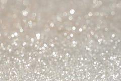 银色闪烁的圣诞灯 被弄脏的抽象假日bac 库存照片