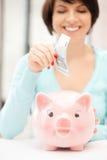 银行可爱的货币贪心妇女 库存照片