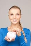银行可爱的货币贪心妇女 免版税库存图片