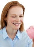 银行女实业家货币贪心节省额年轻人 库存图片