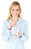银行女实业家货币贪心节省额微笑 免版税库存图片