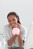 银行女实业家货币贪心节省额 免版税库存图片