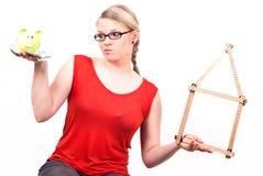 银行房子贪心符号妇女年轻人 免版税库存图片