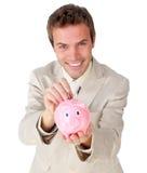 银行生意人货币贪心节省额年轻人 免版税图库摄影