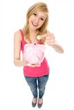 银行硬币贪心放置的妇女 库存照片