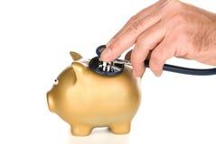 银行被检查的贪心听诊器 免版税库存图片