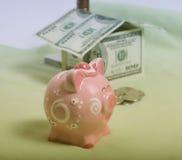 银行贪心房子的货币 免版税库存图片