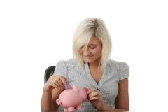 银行贪心桃红色妇女 免版税库存照片