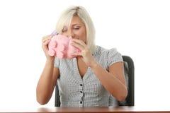 银行贪心桃红色妇女 免版税库存图片
