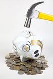 银行锤子被击中的贪心 免版税库存照片