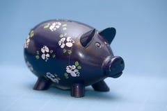银行贪心配件箱的货币 库存照片