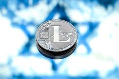 铸造litecoin,以以色列旗子为背景,浓缩 免版税库存照片