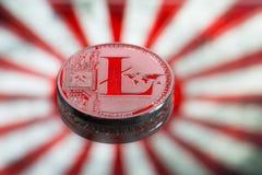 铸造litecoin,在日本和日本旗子背景, 免版税库存图片