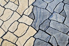 铺抽象的背景包括不规则的石头 免版税图库摄影