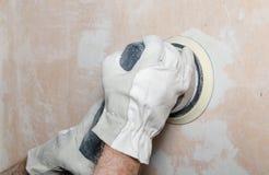 铺沙有力量沙磨机的墙壁 库存照片
