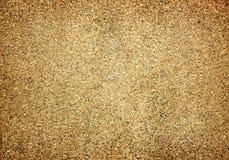 铺沙有红砖的墙壁纹理背景的 库存照片