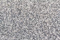 铺沙石小卵石纹理或铺沙室内设计事务的石小卵石背景 外部装饰设计 库存照片