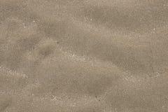 铺沙纹理或无缝的沙子背景或沙滩 库存图片