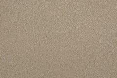 铺沙纹理或无缝的沙子背景或沙滩 免版税库存照片