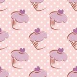 铺磁砖样式用杯形蛋糕和圆点背景 免版税库存照片