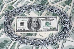 链子的100个美元和圈子 免版税库存图片