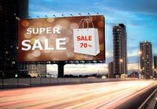 销售概念,室外广告牌,超级销售 图库摄影