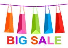 销售横幅五颜六色的购物袋 免版税库存照片
