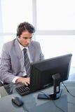 销售额助手与监控程序一起使用 库存照片