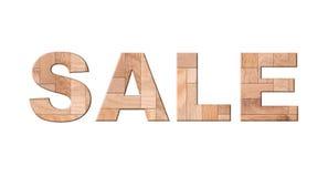 销售,在白色的木木条地板信件孤立 免版税图库摄影