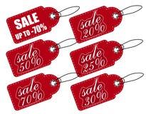 销售,价牌红色 一套各种各样的折扣 在白色背景隔绝的标志 免版税图库摄影