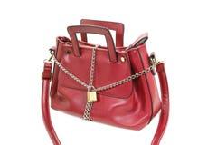 锁、链子和妇女袋子 免版税图库摄影