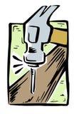 锤击击中钉子入木头 图库摄影