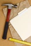 锤子和测量的磁带 库存照片